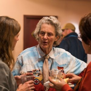 Dr. Temple Grandin visits with Maddy Butcher and Dr. Sheryl King